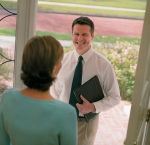 A moving agent greeting a customer.