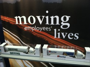 moving employees lives sign