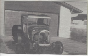 An old photo from a newspaper of an old car