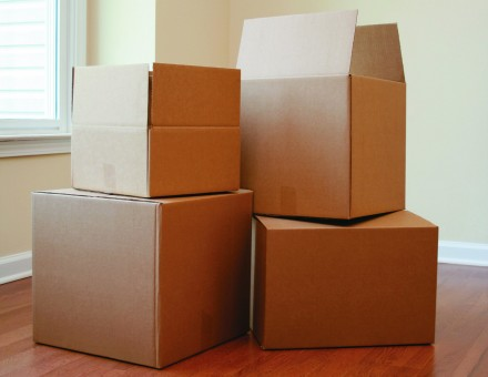 Packing boxes scattered in an empty room
