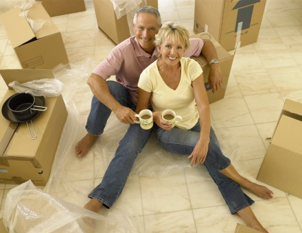 Couple packing and having coffee
