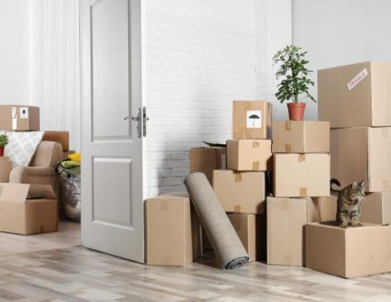 Stacked moving boxes in a home. Remember to pack everything!