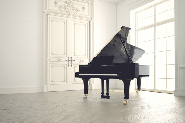 Grand piano in a fancy, clean white room