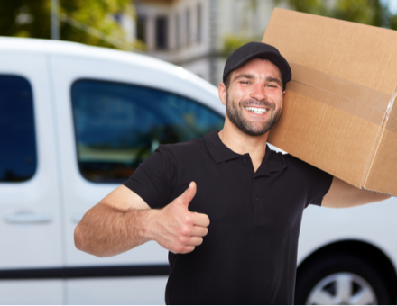 Mover giving thumbs up while a box inside