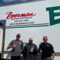 boerman employees in masks giving a thumbs up