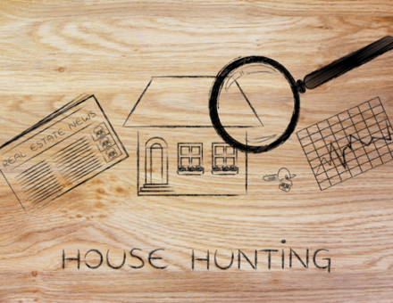 magnifying glass analyzing a house, with sector newspaper, stats and keys
