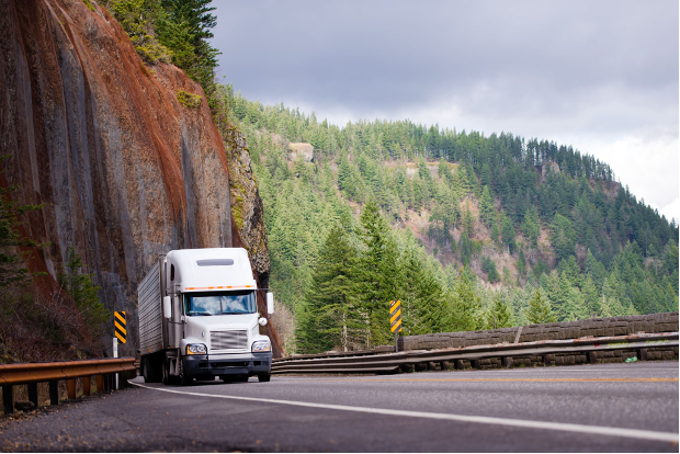 Moving truck driving on winding mountain road